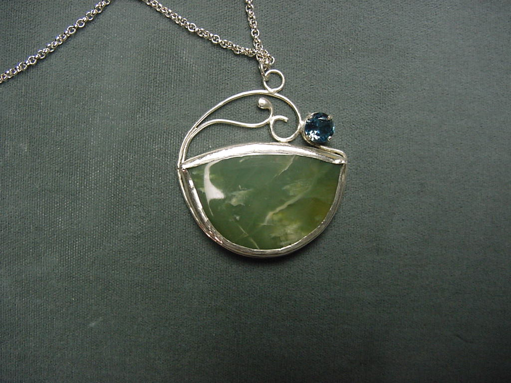 one of my signature pieces - green agate cabachon and faceted blue topaz combined in a pendant