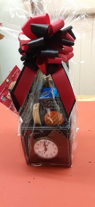 leatherette box with working clock, filled with goodies